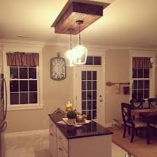 replaced the fluorescent lighting kitchen island lighting