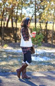 street riding boots plaid tunic black leggings brown riding boots tory burch