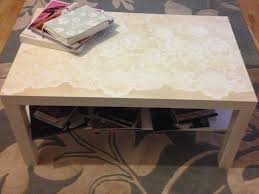 ikea hack lack table painted white and spray painted using a net