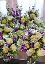 wedding flowers calgary mondial ivory roses purple stock mixed foliage