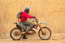 bike motocross man in red sweater driving dirt bike free stock photo