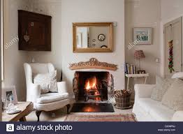 Home Design Stock Images by Living Room With Lit Fire In Bristol Home Of British Fabric