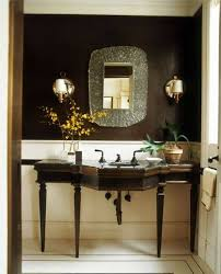 half bath design with console vanity with legs and decorative