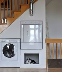 clever built under stair laundry and pet beds