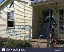 katrina house post hurricance katrina house damaged by the storm spray paint