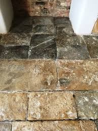 cleaning and restoring the appearance of an old flagstone floor