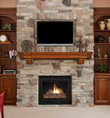 square black fireplace with brown wooden shelf and tv above placed