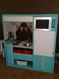kids play kitchen made from a tv stand for the home d i y