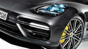 porsche headlights at night panamera the sports car among luxury saloons