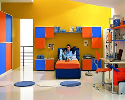 boys bedroom idea with yellow wall paint color and orange blue