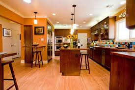 modern home interior design burnt orange kitchen white cabinets