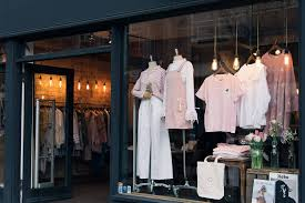 articles with clothing store window about us