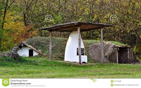 Earth Sheltered House Plans White Furnace In Front Of Rustic Earth Sheltered House Royalty
