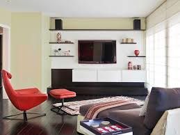 floating shelves wall mounted tv brown sofa cabinets light wood