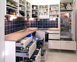 file white kitchen with cabinet doors and drawers opened or