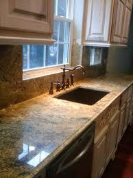 santa cecelia granite copper sink antique white cabinets brass