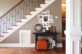 photo gallery wall under the stairs house tour taupe stairs
