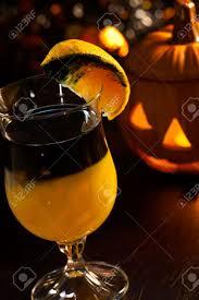 closeup of rotten pumpkin cocktail black vodka orange juice