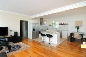 gorgeous ultra modern kitchen with family room also sleek cabinets