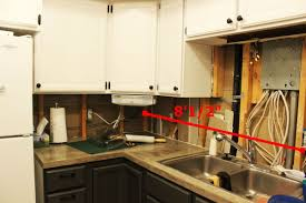 how to install or repair drywall for a kitchen backsplash cut the new drywall pieces to your space