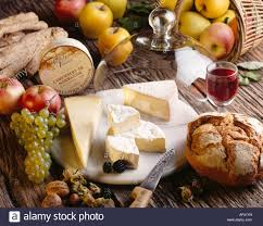 cheese platter with french cheese bread u0026 glass of red wine stock