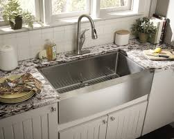 decorating white kitchen cabinets with bronze apron front sink
