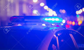 blue light on car blue light flasher atop of a police car city lights on the