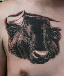 black ink bull head tattoo on front shoulder by anders grucz