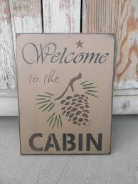primitive rustic northwoods lodge welcome to the cabin hand