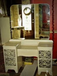corner white stained wooden vanity table with glass table top and