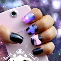 black and pink purple blue galaxy nail art with cross and bow
