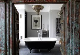bathroom black bathup with white surface and black clawfoot tub