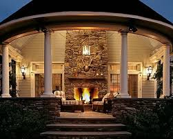 log cabin outdoor lighting log cabin with a tin roof and a wrap around porch description from