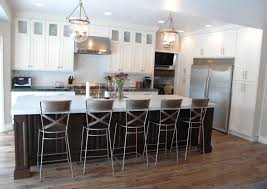 White Kitchens With Islands by A Transitional White Kitchen With A Dark Cherry Wood Island