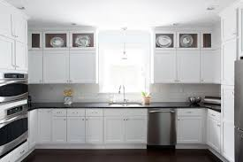 white kitchen cabinets with wood crown molding white kitchen cabinets with black countertops transitional