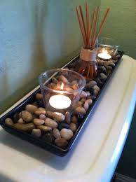 cheap rocks from ikea a couple candles and a scented oil reed