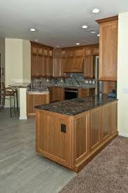 gray kitchen floors with oak cabinets cherry cabinetry wood cabinets with gray floors