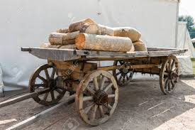 russian wooden cart wagon with firewood on one show