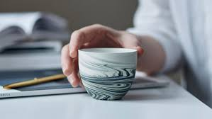 a collection of espresso cups designed with unique decorative