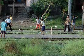 boys playing cricket on train tracks india cricket pinterest