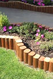 check out the creative use of landscape timbers as borders cut