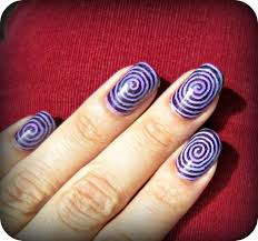 purple spiral design halloween nail art