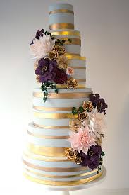wildflower cakes london oplulent wedding cake with gold leaf bands