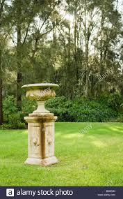 an ornamental bird bath set in the gardens of a restaurant in the