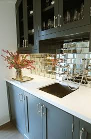 mirror tile backsplash kitchen this kitchen features mirrored subway tiles source
