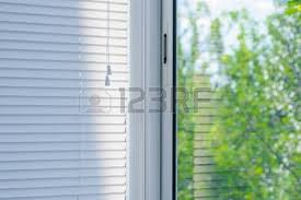 Blinds In The Window Sunlight Coming Through Venetian Blinds By The Window Stock Photo