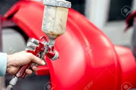 Red Paint by Close Up Of Spray Gun With Red Paint Painting A Car In Special
