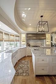 love this kitchen notice the sink and the working sink behind it boyse residence white kitchen with ceiling cutout marble counters wood plank flooring and large kitchen island