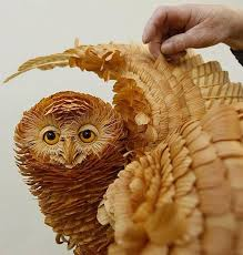 intricate animal sculptures made from wood chips twistedsifter
