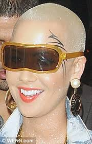 amber rose steps out with mike tyson inspired etching around her